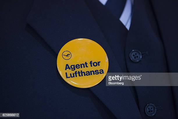 An employee wears a badge reading 'Agent for Lufthansa' as Lufthansa pilots strike over renumeration and work conditions at Frankfurt Airport in...
