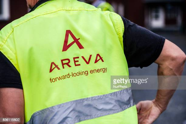 An employee wears an Areva safety vest at the construction site of the Olkiluoto3 nuclear power plant in Olkiluoto Eurajoki Finland on 17 August 2017