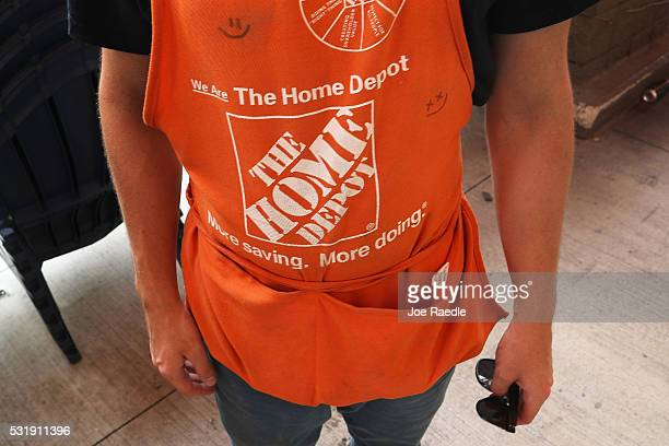 An employee wears his apron at The Home Depot store on May 17 2016 in Miami Florida Home Depot raised its yearly outlook after first quarter sales...