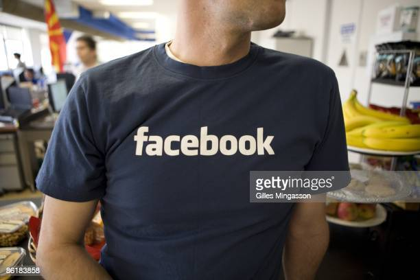 An employee wears his company's colors at the Facebook headquarters where the atmosphere is casual and laidback in Palo Alto March 31 2009 Founded in...
