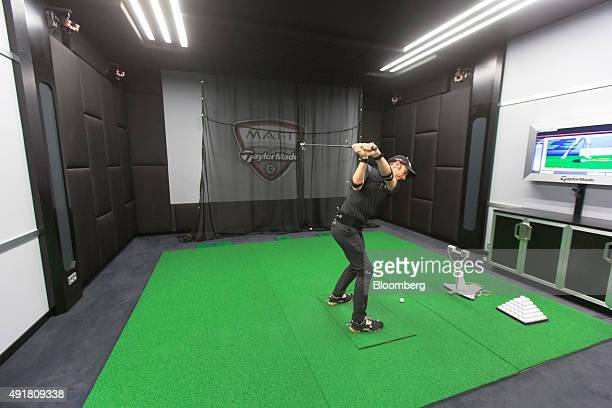 An employee wears sensors as he swings a golf club in the motion analysis technology room at the TaylorMade center of excellence operated by Adidas...