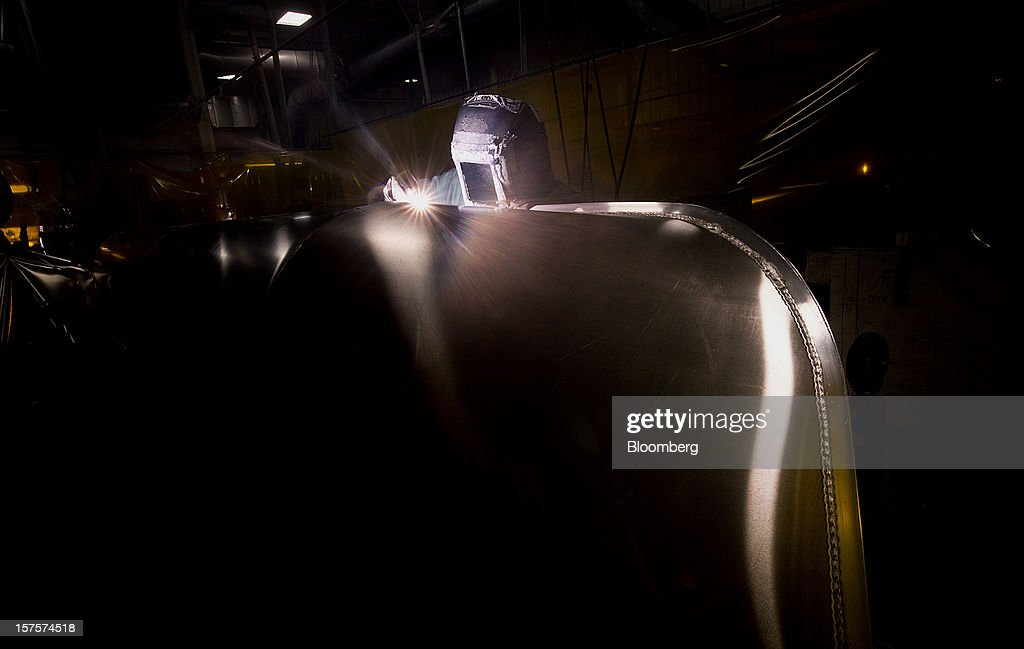 An employee welds a beed onto the nose of an aluminum pontoon boat during the fabrication process at the Nautic Global Group production facility in Elkhart, Indiana, U.S., on Tuesday, Dec 4, 2012. The U.S. Census Bureau is scheduled to release factory orders data on Dec. 5. Photographer: Ty Wright/Bloomberg via Getty Images