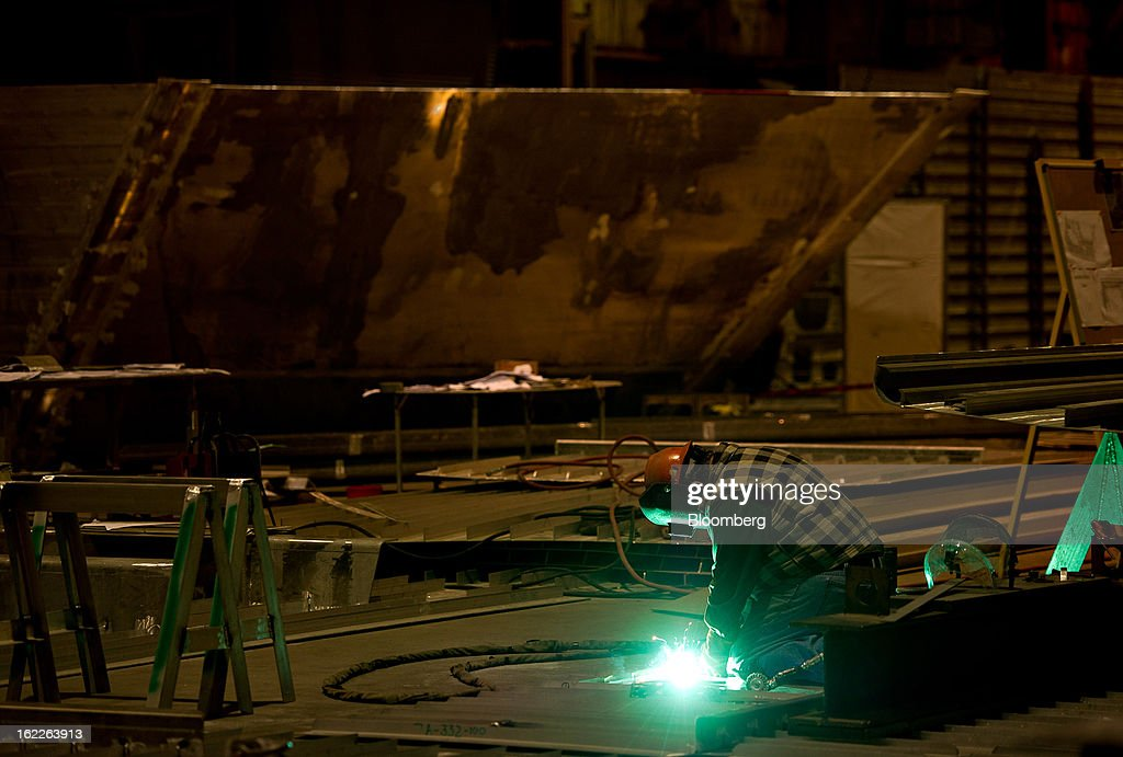 An employee welds an aluminum component of a U.S. Navy Littoral Combat Ship (LCS) at Marinette Marine Corp., in Marinette, Wisconsin, U.S., on Monday, Feb. 11, 2013. Marinette Marine Corp. makes one version of the Littoral Combat Ship in partnership with Lockheed Martin Corp. As the Pentagon faces $500 billion in spending cuts over a decade that are set to begin March 1, the $37 billion program to design and build Littoral Combat Ships may become a target for reductions that would take business from Lockheed and Austal Ltd., which also makes a version of the ship in partnership with General Dynamics Corp. at Austal's yard in Mobile, Alabama. Photographer: Daniel Acker/Bloomberg via Getty Images