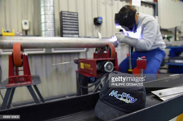 An employee welds metal discs of hydrogen on a tube on November 6 2015 at the McPhy Energy company in La MotteFanjas southeastern France The...