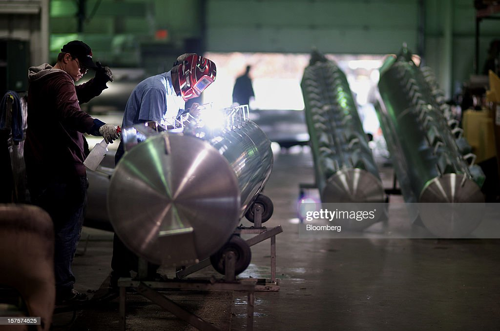 An employee welds mounting brackets to an aluminum pontoon during the fabrication process at the Nautic Global Group production facility in Elkhart, Indiana, U.S., on Tuesday, Dec 4, 2012. The U.S. Census Bureau is scheduled to release factory orders data on Dec. 5. Photographer: Ty Wright/Bloomberg via Getty Images
