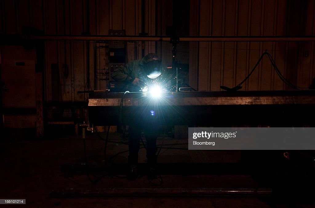 An employee welds on the exterior of a steel pole at the Rohn Products LLC manufacturing facility in Peoria, Illinois, U.S., on Wednesday, Oct. 31, 2012. Manufacturing in the U.S. probably expanded in October at a slower pace, indicating the industry is providing little thrust for the expansion, economists said before a report today. Photographer: Daniel Acker/Bloomberg via Getty Images