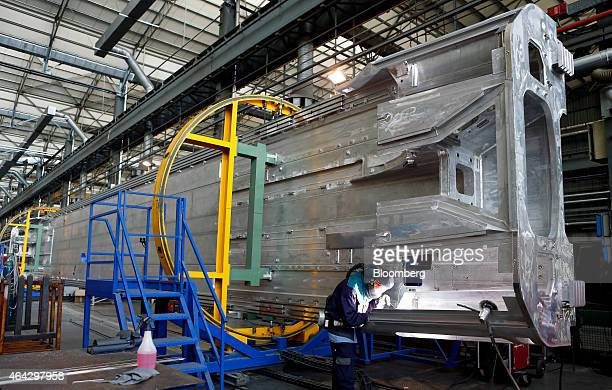 An employee welds sections of bodywork during the manufacture of Frecciarossa 1000 highspeed train carriages at AnsaldoBreda SpA's railcar plant in...