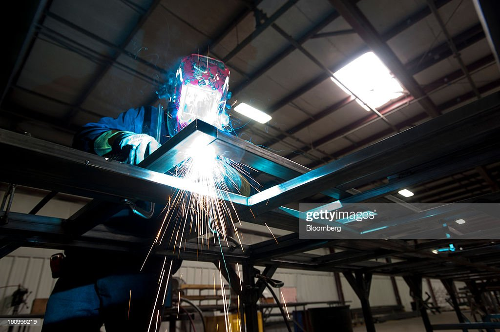 An employee welds steel frames for the exterior walls of a Class C motorhome at Nexus RV in Elkhart, Indiana, U.S., on Friday, Feb. 8, 2013. Orders placed with U.S. factories increased less than forecast in December, reflecting a drop in non-durable goods that partly countered gains in construction equipment and computers. Photographer: Ty Wright/Bloomberg via Getty Images