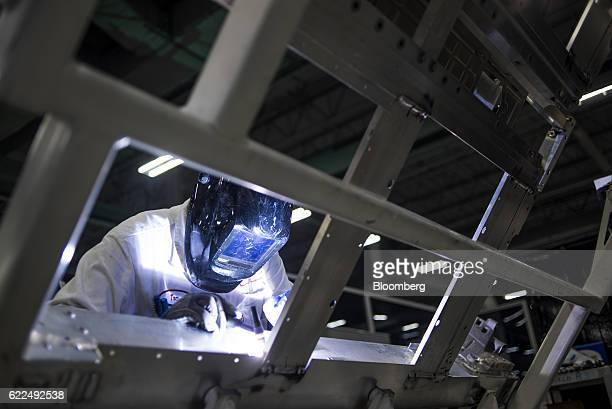 An employee welds the chassis of a Honda Motor Co 2017 Acura NSX vehicle at the Honda Performance Manufacturing Center in Marysville Ohio US on...