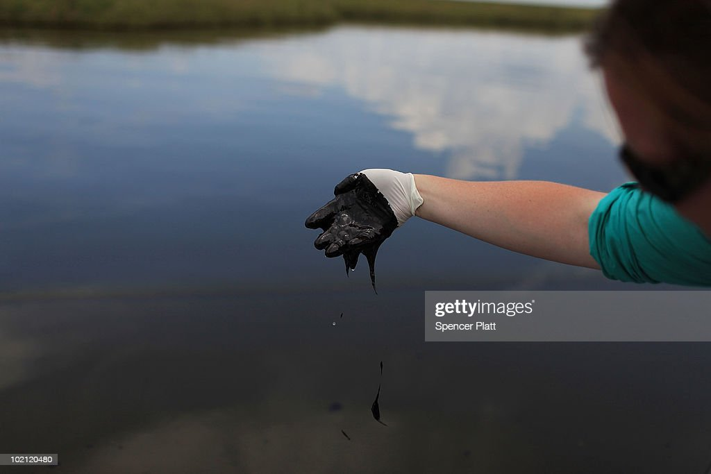 An employee with the governor's office collects oil for research purposes in Bay Jimmy on June 15, 2010 off of Grand Isle, Louisiana. The BP spill has been called the largest environmental disaster in American history. U.S. government scientists have estimated that the flow rate of oil gushing out of a ruptured Gulf of Mexico oil well may be as high 40,000 barrels per day. Following his fourth trip to the Gulf on Monday, President Barack Obama will address the nation in an Oval Office speech today on the situation in the Gulf.