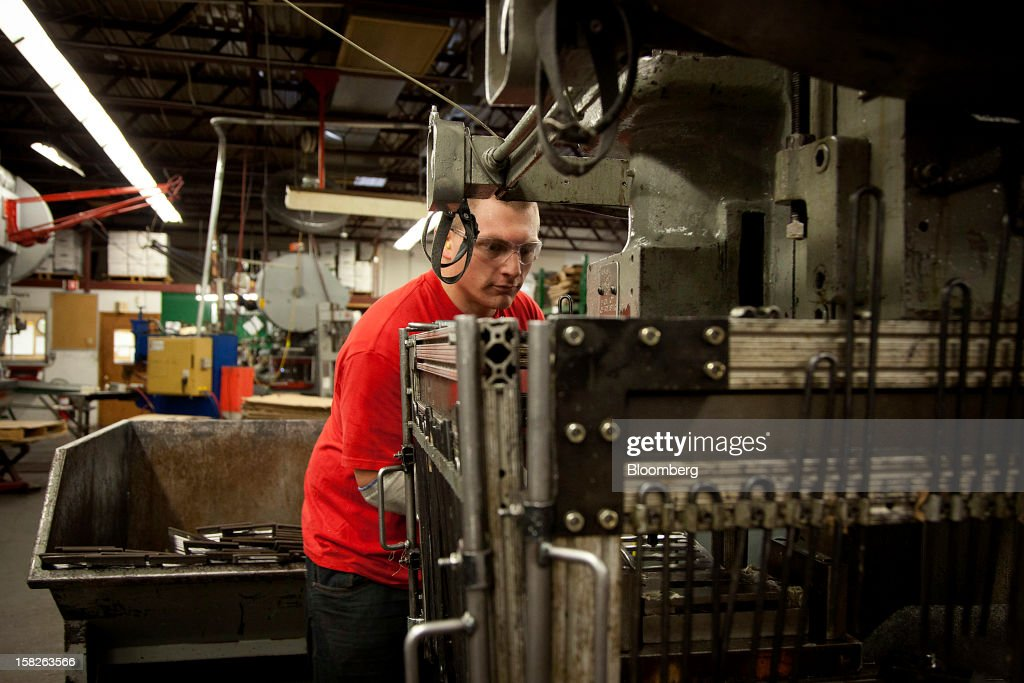 An employee works a machine at the E.J. Ajax & Sons metalforming company in Minneapolis, Minnesota, U.S., on Thursday, Dec. 6, 2012. The U.S. Federal Reserve is scheduled to release industrial production data on Dec. 14. Photographer: Ariana Lindquist/Bloomberg via Getty Images