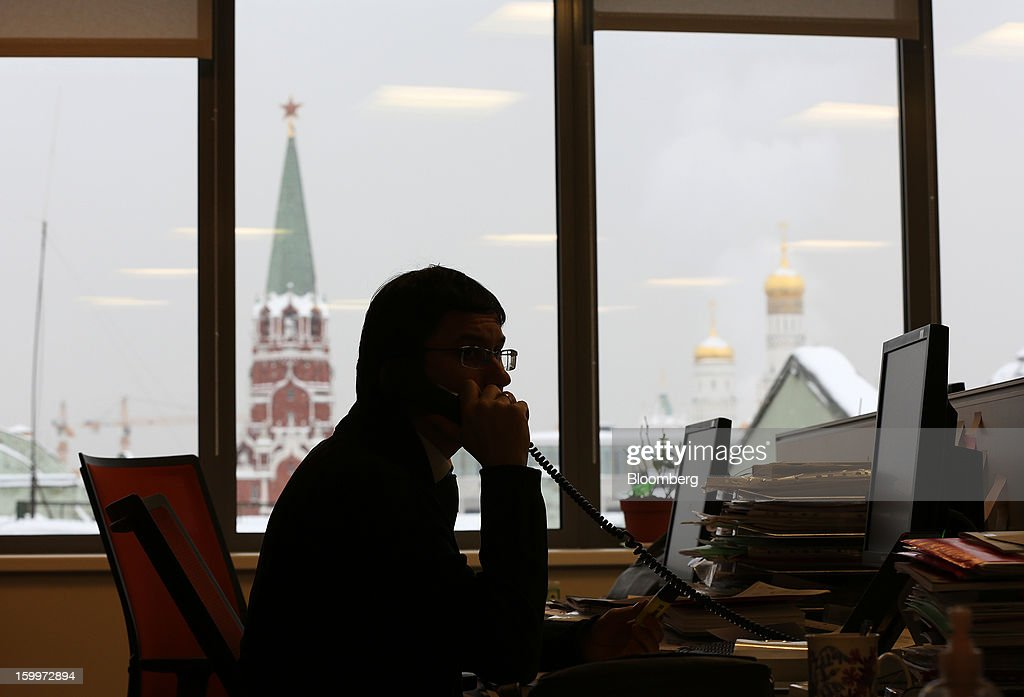 An employee works at a desk overlooking the Kremlin in the Moscow Exchange in Moscow, Russia, on Thursday, Jan. 24, 2013. The Moscow Exchange, Russia's biggest bourse, plans to raise more than $500 million in an initial public offering, according to a person with knowledge of the matter. Photographer: Andrey Rudakov/Bloomberg via Getty Images