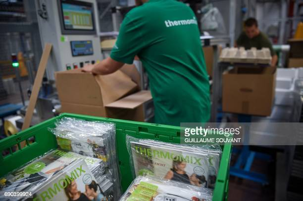 An employee works at a production plant of German group VorwerkSemco where the Thermomix kitchen foodprocessor is manufactured on May 19 2017 in...