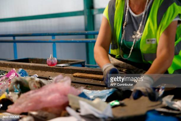 An employee works at a waste management plant in Geri on the outskirts of the Cypriot capital Nicosia on October 5 2017 / AFP PHOTO / Florian CHOBLET