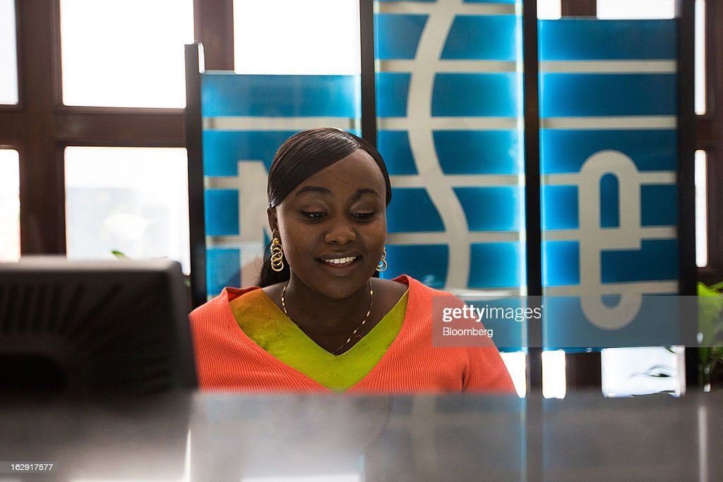 An employee works at her desk inside the Nairobi Stock Exchange (NSE) in Nairobi, Kenya, on Friday, March 1, 2013. Next week's presidential vote will be the first since disputed elections in 2007 triggered ethnic fighting in which more than 1,100 people died and another 350,000 fled their homes. Photographer: Trevor Snapp/Bloomberg via Getty Images