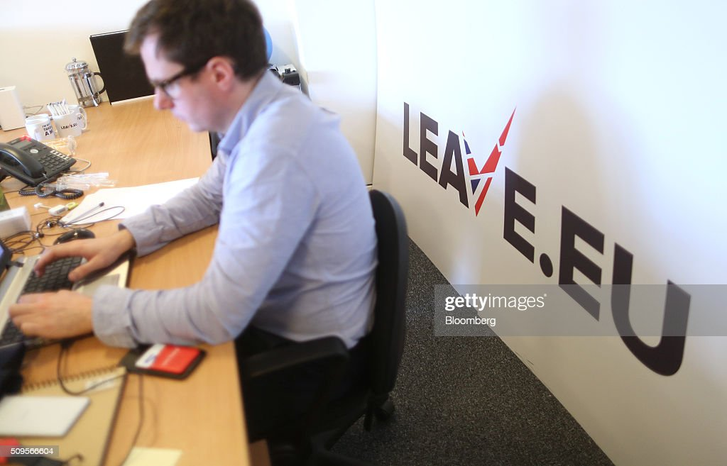 An employee works at his desk inside the Leave.EU campaign headquarters, a party campaigning against Britain's membership of the European Union, in London, U.K., on Thursday, Feb. 11, 2016. Britain's economy could be thrown off track by the planned referendum on European Union membership, according to the Confederation for British Industry. Photographer: Chris Ratcliffe/Bloomberg via Getty Images