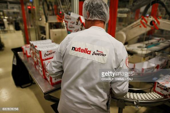 An employee works at the Ferrero plant in VillersEcalles northwestern France on January 27 2017 The Ferrero plant of VillersEcalles is the biggest...
