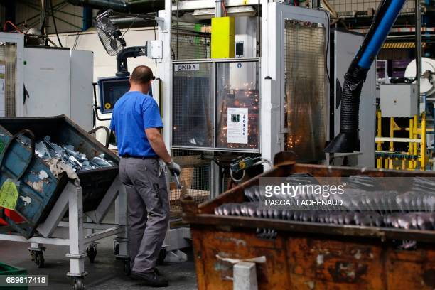 An employee works at the GMS car parts manufacturer site as employees resume work on May 29 2017 in La Souterraine central France Around 280 jobs are...