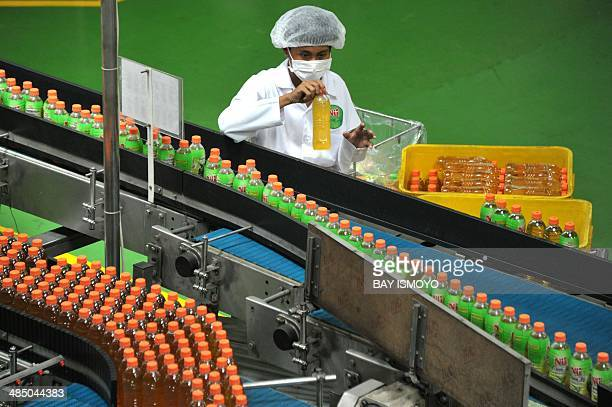 An employee works at the Indonesian food and beverage company PT ABC President Indonesia bottled tea beverage drink product manufacturing plant in...