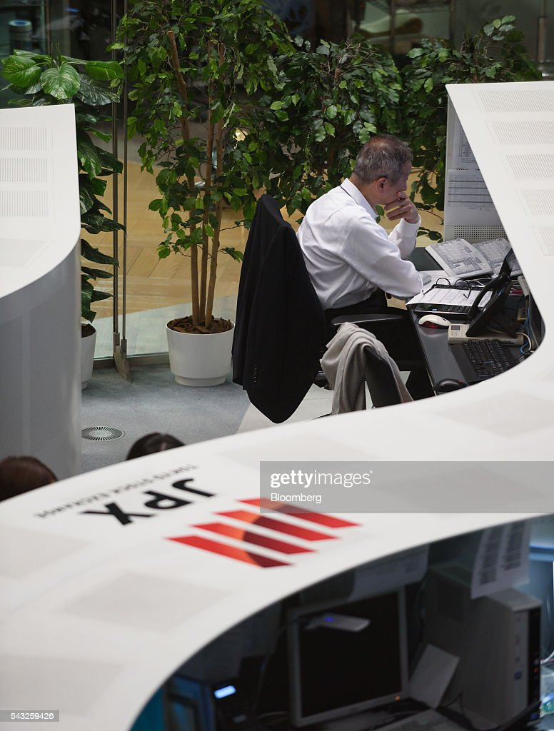 An employee works at the Tokyo Stock Exchange (TSE), operated by Japan Exchange Group Inc. (JPX), in Tokyo, Japan, on Monday, June 27, 2016. The yen was closing in on 99 per dollar at one point Friday and headed for its biggest gain since it was freely floated in February 1973, as Britain's vote to leave the European Union prompted investors to flee global markets and seek safety in Japanese government bonds. Photographer: Akio Kon/Bloomberg via Getty Images
