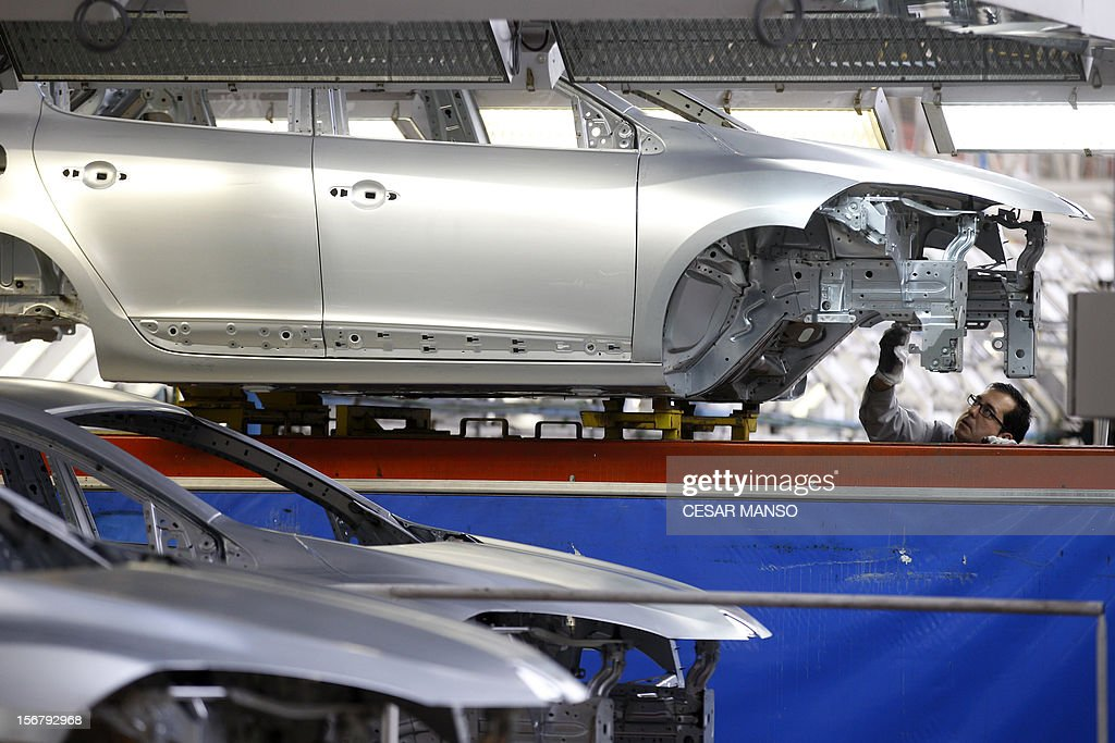 An employee works at the Villamuriel Renault factory in northern Spain on November 21, 2012. French car maker Renault plans to create 1,300 jobs at its factories in recession-hit Spain, Spanish Prime Minister Mariano Rajoy said. The French giant, which employs 10,000 people at four sites in Spain, signed a deal on working conditions with Spanish labour unions last week but is still negotiating terms with workers in France as it seeks to be more competitive.