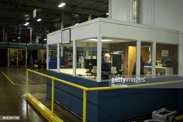 An employee works in a booth at the SEWEurodrive Inc production facility in Lyman South Carolina US on Friday June 23 2017 Productivity in the US...