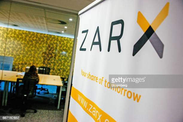 An employee works in an office at the ZAR X South Africa's second stock exchange in Johannesburg South Africa on Tuesday April 11 2017 ZAR X became...