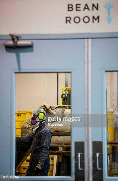 An employee works in the bean room at the Theo Chocolate factory in Seattle Washington US on Monday Feb 2 2015 The US Census Bureau is scheduled to...
