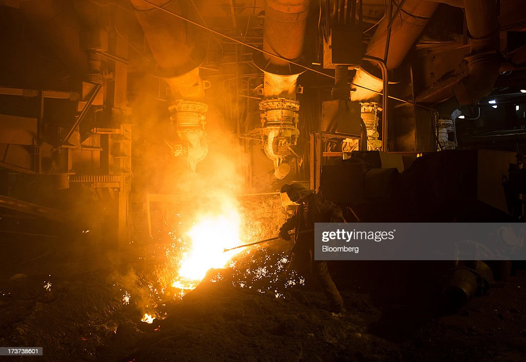 An employee works in the blast furnace at OAO Mechel's metallurgical plant in Chelyabinsk, Russia, on Wednesday, July 17, 2013. Mechel, the country's largest producer of coking coal for steelmakers has begun operating its $700m rail production line which can produce 100 meter rails. Photographer: Andrey Rudakov/Bloomberg via Getty Images