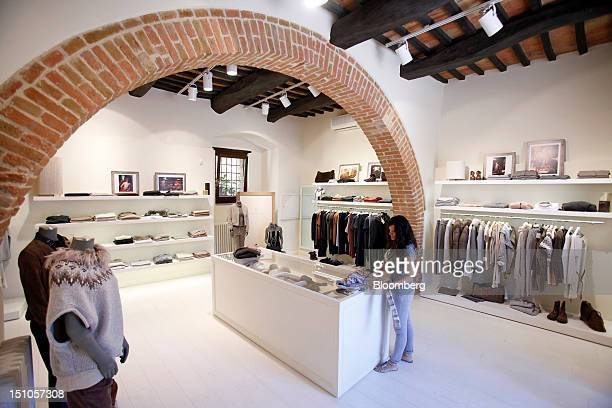 An employee works in the Brunello Cucinelli SpA store in Solomeo near Perugia Italy on Thursday Aug 30 2012 Cucinelli follows competitors Prada SpA...