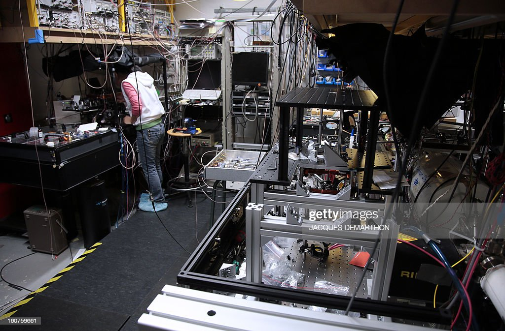 An employee works in the laser datas laboratory where atomic measures are calculated to set the French legal time on February 5, 2013 at Paris' observatory. Paris' observatory is celebrating this year the speaking clock's 80 anniversary.