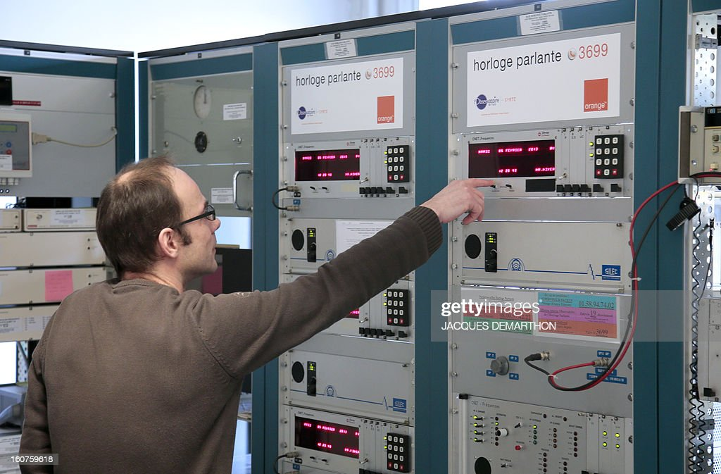 An employee works in the 'time expoitation room' of Paris' observatory on February 5, 2013, from where French legal time datas are sent and controlled. Paris' observatory is celebrating this year the speaking clock's 80 anniversary.
