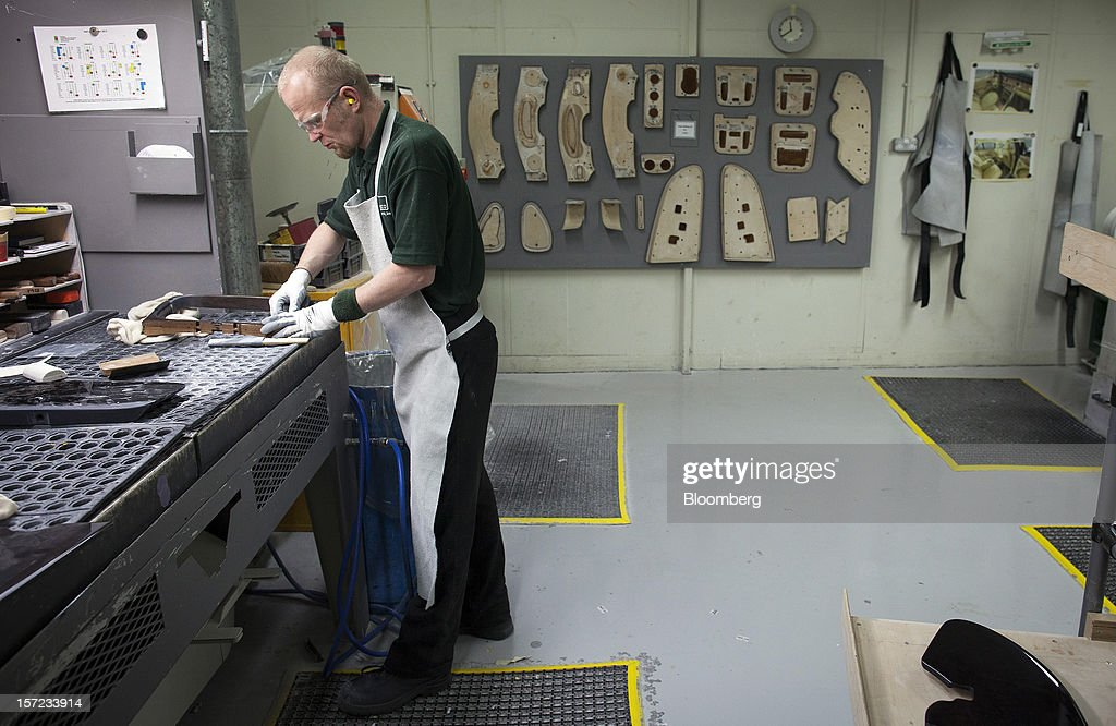 An employee works in the woodshop at the Bentley Motors Ltd. workshop in Crewe, U.K., on Thursday, Nov. 29, 2012. Consumer spending and exports propelled the U.K. economy to its fastest growth since 2007 in the third quarter as the Olympics and a post-Jubilee rebound saw household expenditure rise the most in more than two years. Photographer: Simon Dawson/Bloomberg via Getty Images
