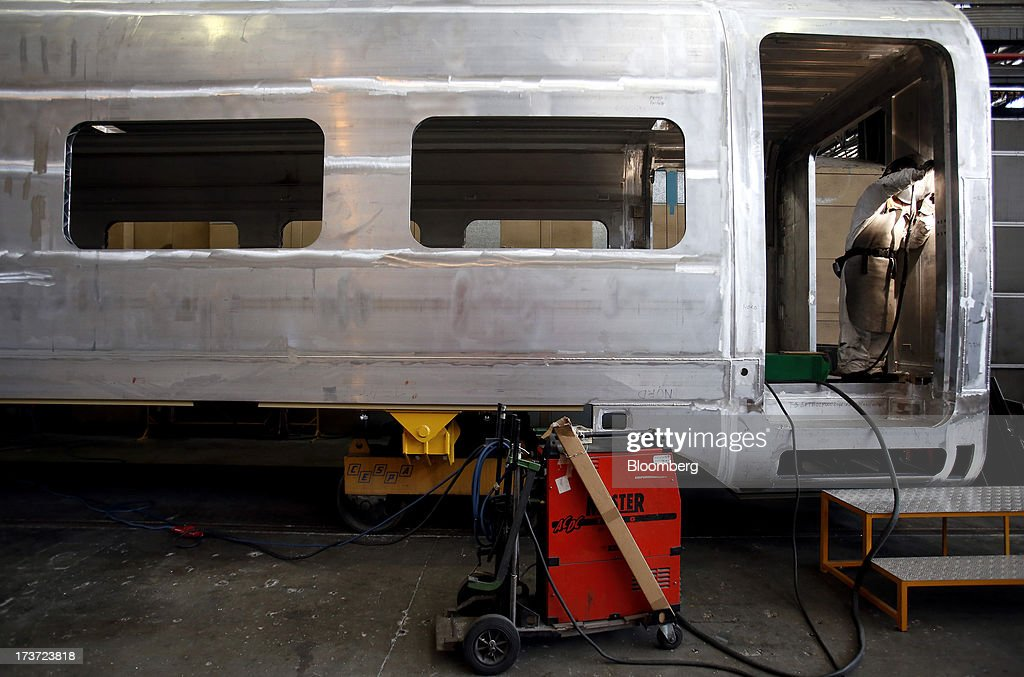 An employee works inside the bare metal carriage of a Frecciarossa 1000 high-speed train carriage during manufacture at AnsaldoBreda SpA's rail-car plant in Pistoia, Italy, on Tuesday, July 16, 2013. Italian business confidence rose last month after Prime Minister Enrico Letta's Cabinet passed plans to boost employment and postponed the payment of the value-added tax planned for July. Photographer: Alessia Pierdomenico/Bloomberg via Getty Images