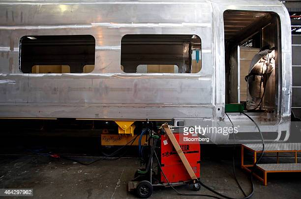An employee works inside the bare metal carriage of a Frecciarossa 1000 highspeed train carriage during manufacture at AnsaldoBreda SpA's railcar...