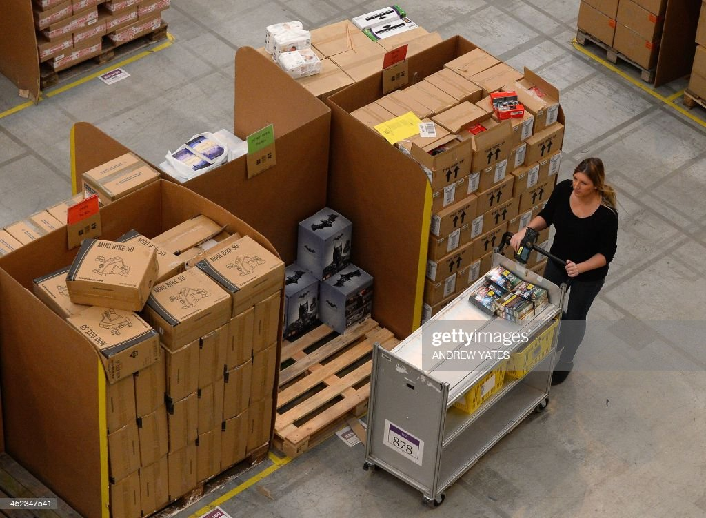 An employee works inside the Fulfilment Centre for online retail giant Amazon in Peterborough, central England, on November 28, 2013, ahead of Cyper Monday on December 2nd, expected to be one of the busiest online shopping days of the year.