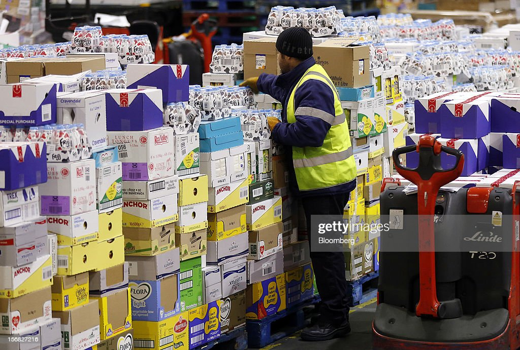 An employee works inside WM Morrison Supermarkets Plc's distribution center in Wakefield, U.K., on Thursday, Nov. 22, 2012. Britain's economy will return to growth next year after stagnating in 2012, with expansion weighted in the second half, according to Bank of England projections published yesterday. Photographer: Simon Dawson/Bloomberg via Getty Images