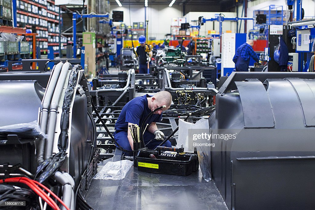 An employee works on a bus chassis during assembly on the production line at Volvo AB's bus manufacturing plant in Wroclaw, Poland, on Friday, Jan. 11, 2013. Volvo plans to end bus making in Saeffle by June 2013, and will consolidate the business in Europe to its main plant in Wroclaw, Poland, the Gothenburg, Sweden-based company said. Photographer: Bartek Sadowski/Bloomberg via Getty Images