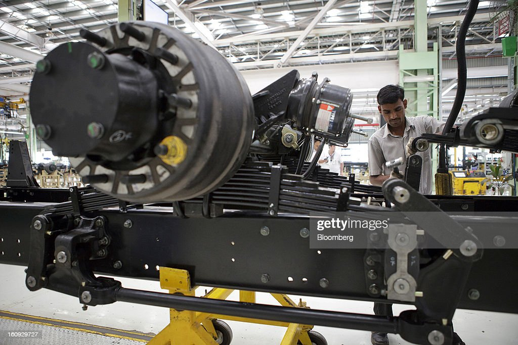 An employee works on a chassis on the assembly line for the Mahindra & Mahindra Ltd. Navistar truck at the company's factory in Chakan, Maharashtra, India, on Wednesday, Feb. 6, 2013. Mahindra & Mahindra is scheduled to announce third-quarter earnings today. Photographer: Kuni Takahashi/Bloomberg via Getty Images
