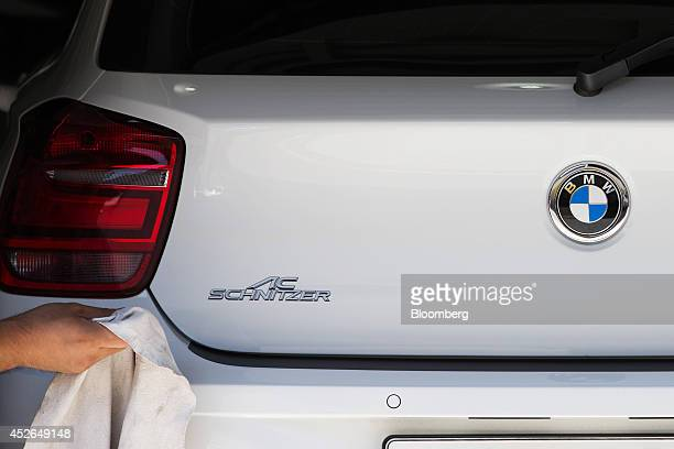 An employee works on a customized Bayerische Motoren Werke AG Series 1 118d vehicle at the ASeung Automotive Group garage in Seoul South Korea on...