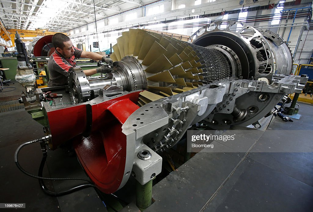 An employee works on a gas turbine rotor assembly at Ansaldo Energia SpA's power-plant production facility in Genoa, Italy, on Friday, Jan. 18, 2013. Finmeccanica SpA is seeking binding bids for assets, including a majority stake in Ansaldo Energia, by Jan. 23, while a final decision will be made at a later board meeting, Ansa reported Jan. 16. Photographer: Alessia Pierdomenico/Bloomberg via Getty Images