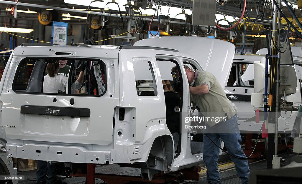 An employee works on a Jeep Liberty at Chrysler Group LLC's Toledo Assembly Complex in Toledo, Ohio, U.S., on Wednesday, Nov. 16, 2011. Chrysler Group LLC said it will invest $1.7 billion to update a Jeep sport-utility vehicle and add a second shift at its factory in Toledo in the third quarter of 2013. Photographer: Jeff Kowalsky/Bloomberg via Getty Images