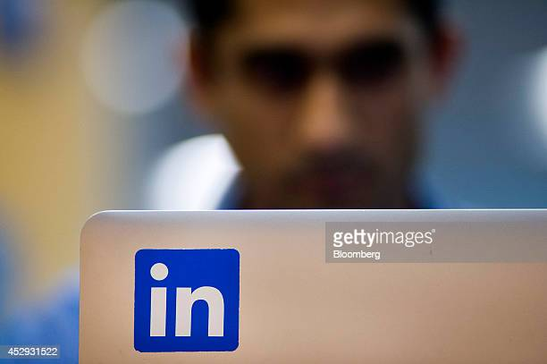 An employee works on a laptop computer at LinkedIn Corp headquarters in Mountain View California US on Monday July 28 2014 LinkedIn Corp is scheduled...