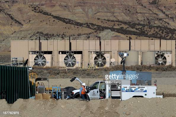 An employee works on a natural gas well head at a compressor station in a field west of Rifle Colorado US on Dec 3 2012 Natural gas futures declined...