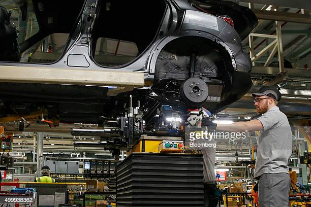 An employee works on a Nissan Juke on the production line at the Nissan Motor Co production plant in Sunderland UK on Thursday Dec 3 2015 Nissan rose...