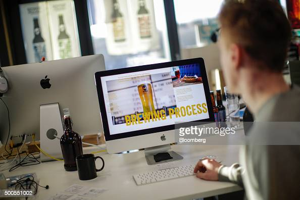An employee works on a presentation using an Apple Inc iMac computer in the Brewdog Plc brewery and headquarters near Aberdeen UK on Tuesday Dec 8...