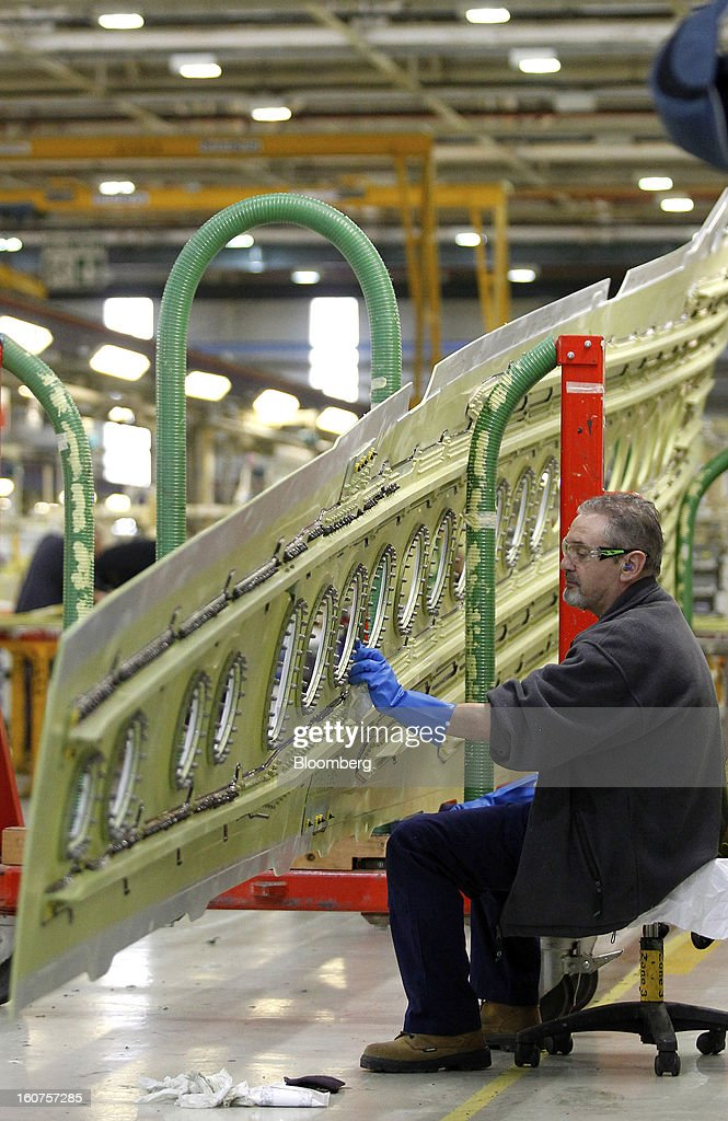 An employee works on a section of an Airbus A320 single-aisle passenger aircraft wing during production at the company's factory in Broughton, U.K., on Monday, Feb. 4, 2013. Airbus SAS won a $9 billion order from Steven Udvar-Hazy's Air Lease Corp. that includes 25 A350 wide-body jets, a competitor to Boeing Co.'s grounded 787 Dreamliner. Photographer: Paul Thomas/Bloomberg via Getty Images