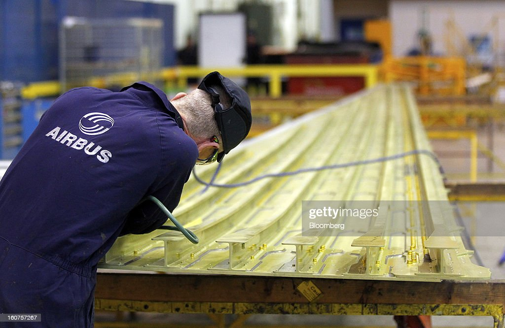 An employee works on a section of wing for an Airbus A330 passenger aircraft at the company's factory in Broughton, U.K., on Monday, Feb. 4, 2013. Airbus SAS won a $9 billion order from Steven Udvar-Hazy's Air Lease Corp. that includes 25 A350 wide-body jets, a competitor to Boeing Co.'s grounded 787 Dreamliner. Photographer: Paul Thomas/Bloomberg via Getty Images