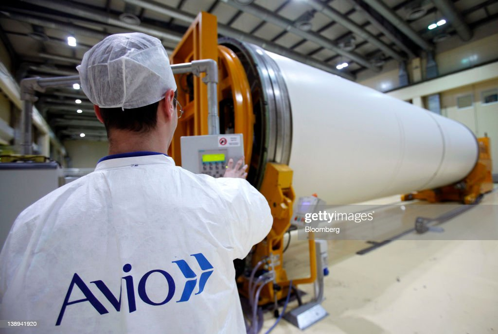 An employee works on a segment of an Avio SpA Ariane 5 space rocket booster at the company's production plant in Colleferro, near Rome, Italy, on Monday, Feb. 13, 2012. Avio, an Italian provider of aerospace services and equipment including gearboxes for aircraft engines, aims to sell shares to the public when the market improves, Chief Executive Officer Francesco Caio said in an interview. Photographer: Alessia Pierdomenico/Bloomberg via Getty Images