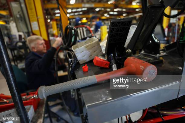 An employee works on a wheel arch section of an Enviro 200 bus at the Alexander Dennis Ltd factory in Guildford UK on Monday Sept 11 2017...